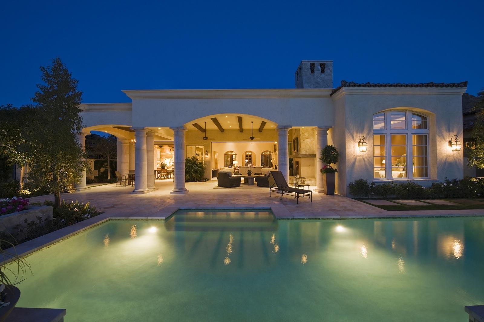 bigstock-Lit-swimming-pool-and-building-48713813